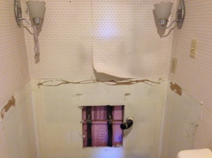 Remove popcorn ceiling and wallpaper, paint, tile floor and new vanity.  Easy, peasy!