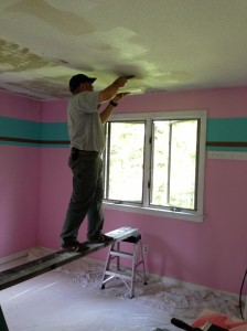 I remember when we let Marley paint it any colors she wanted.  To get the house ready to sell we had to scrape off the popcorn ceiling and tone it down.  BEFORE